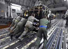Large cases being manhandled onto transport aircraft
