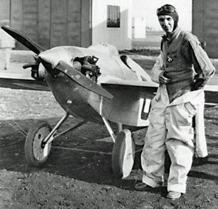 Ed Heath pictured by a scarily small looking single engined mid-winged aircraft (black and white)