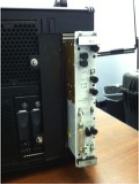 VME Tuner module partially removed from VME slot in lunchbox chassis