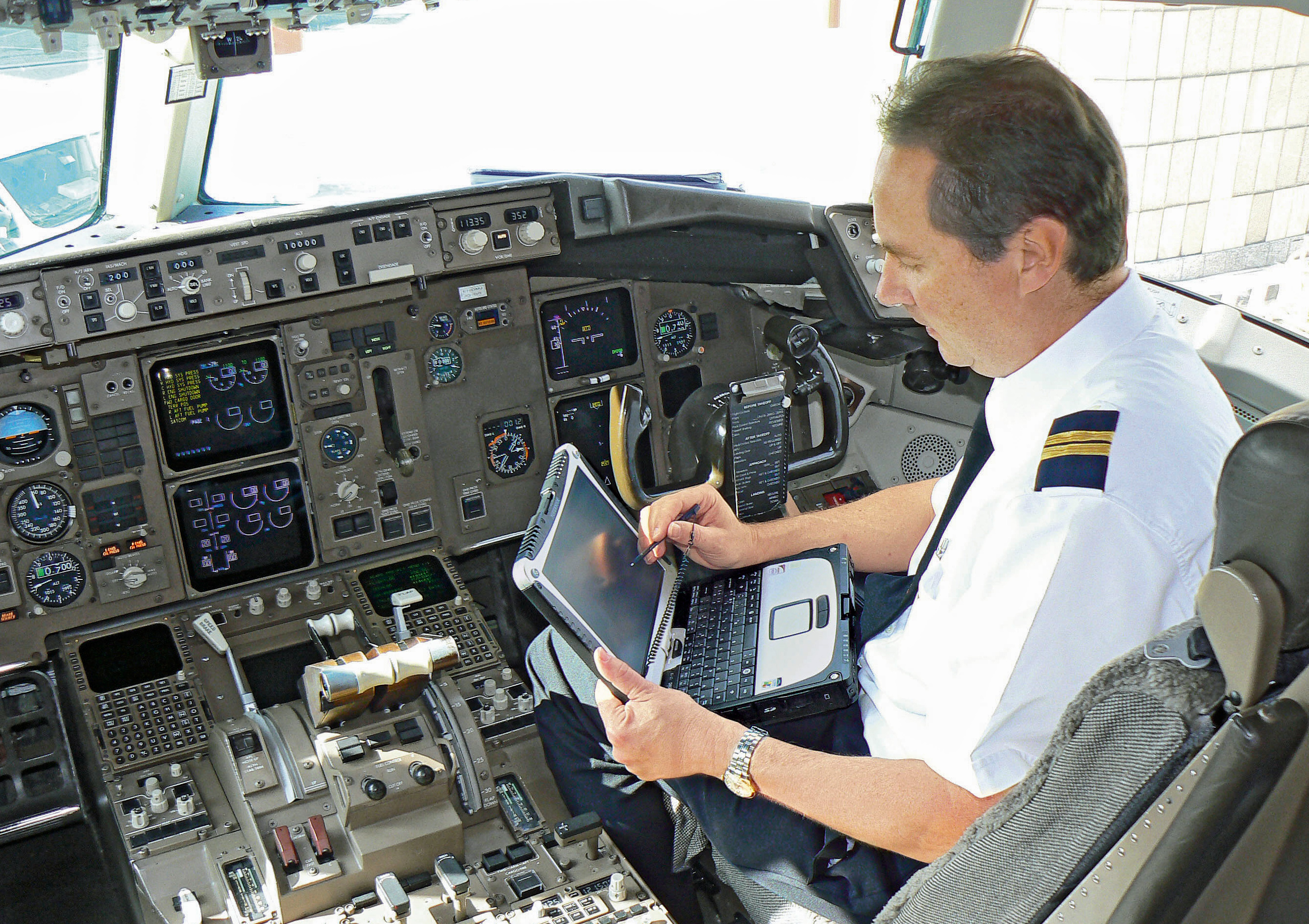 Pilot with CF19 in cockpit stting